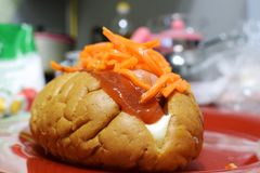 Simple hot dog with sausage, ketchup, carrot stock photography