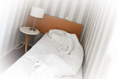 Simple hotel room, single bed Royalty Free Stock Images