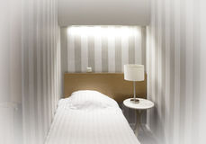 Simple hotel room, single bed Stock Photo