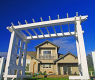 Simple House. A normal home framed by a white fence Royalty Free Stock Photography