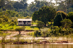 Simple house on Amazon river island Royalty Free Stock Image