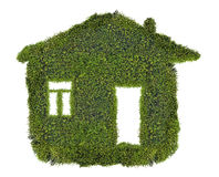Simple house from green moss isolated on white Royalty Free Stock Photo