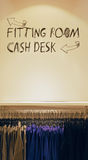Simple Information in a Fashion House. On Fitting Room and Cash Desk Royalty Free Stock Photos