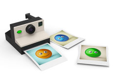 Simple instant photo camera with smiley symbol photos Royalty Free Stock Photo