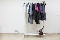 Simple interior of hallway with clothes on hangers, copy space Stock Images