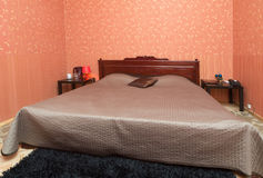 Simple interior of a small bedroom Royalty Free Stock Photo