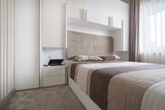 Simple white bedroom Stock Image