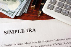 Simple ira. Papers with simple ira and book on a table stock image
