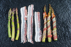 Simple italian dish, asparagus with bacon or pancetta Royalty Free Stock Image