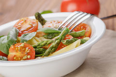 Simple italian pasta penne with tomatoes and basil Royalty Free Stock Image