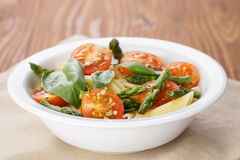 Simple italian pasta penne with tomatoes and basil Stock Photo