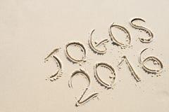 Simple Jogos 2016 Message Handwritten on Sand Beach Royalty Free Stock Image