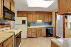 Simple kitchen with hardwood floor. Stock Images