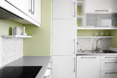 Simple kitchen in white colors Royalty Free Stock Photography