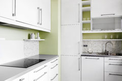 Simple kitchen in white colors Royalty Free Stock Photos