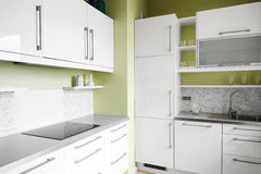 Simple kitchen in white colors Stock Photos