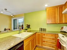 Simple kitchen with wooden cabinets and granite counter top. Simple kitchen room interior with wooden cabinets and granite counter top. Northwest, USA royalty free stock photos
