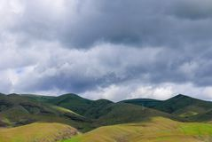 Simple rolling hills in Lewiston Idaho with cloudy sky. Simple landscape with rolling, barren, green and brown hills with cloudy sky Stock Photography