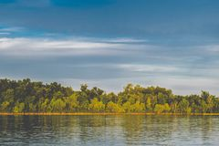 A simple landscape in the Rostov region in Russia, the river - Seversky Donets, Don. Spring is the beginning of summer. Green vege Royalty Free Stock Images