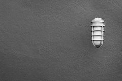 Simple lantern on the a gray wall Royalty Free Stock Photo