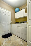 Simple laundry room interior Stock Image