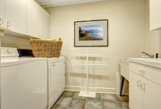 Simple laundry room with old washer and dryer Royalty Free Stock Images