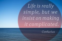 Simple life Confucius. Life is really simple, but we insist on making it complicated - quote of ancient Chinese philosopher Confucius  printed over photo with Royalty Free Stock Photography