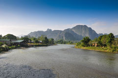 Simple life on the river,Vang Vieng, Loas. Simple life on the river, Mountain in background,Vang Vieng, Loas Royalty Free Stock Photography
