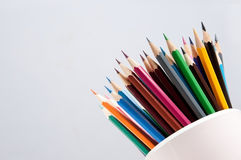Simple light background with a set of colored pencils Royalty Free Stock Images