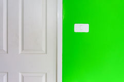 Simple light switch on a green wall Stock Photos