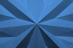 Blue, star shaped folded, paper as abstract background. royalty free stock images