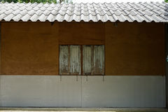 Simple local house side elevation showing plywood wall, white ru Royalty Free Stock Photography