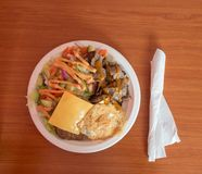 Unhealthy food, simple plate with kebab, egg, cheese, beef and salad served at a inexpensive restaurant. Simple lunch plate with kebab, egg, cheese, beef and Royalty Free Stock Photography