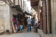 Simple market street in Stone town. ZANZIBAR, TANZANIYA- JULY 16: simple market street with people in Stone townon July 16, 2016 in Zanzibar, Tanzania Stock Photography