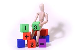 Simple Math. Manny's doing his homework - one plus two equals three Stock Images