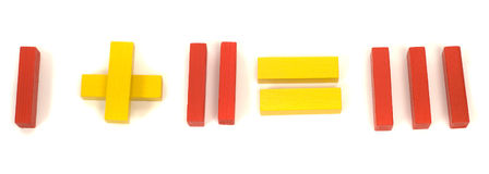 Simple Math. Red and yellow blocks spelling out that 1 and 2 equals 3 Royalty Free Stock Photography