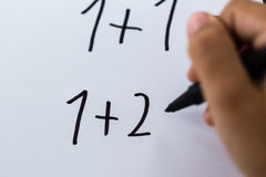 Simple math. Close-up of simple math written on white piece of paper Royalty Free Stock Photo
