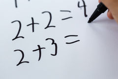 Simple math. Close-up of simple math written on white piece of paper Stock Photography