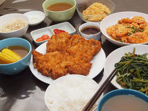 Simple Meal. A simple meal of Pork Chop, Cereal Prawns, Sambal Kangkong & soup served with rice Stock Photos
