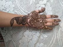 Simple Mehndi Design. Mehndi is a traditional art of painting the hands and feet with a paste made up of dried leaves of henna plant stock photography
