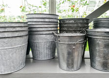Simple metal flower pots on a shelf Royalty Free Stock Photos