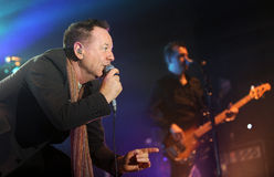 Simple Minds. Singer James Kerr (left) of Simple Minds during performance in Prague, Czech republic, February 28, 2014 Stock Image