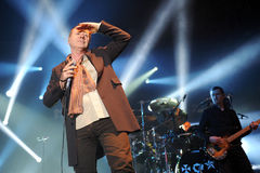 Simple Minds. Singer James Kerr (left) of Simple Minds during performance in Prague, Czech republic, February 28, 2014 Stock Photography