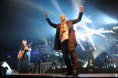 Simple Minds concert. Singer James Kerr (in the middle) of Simple Minds during performance in Prague, Czech republic, February 28, 2014 Stock Photo