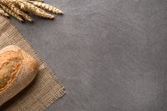Simple minimalistic bread background, fresh bread and wheat. Top view royalty free stock photos