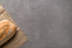 Simple minimalistic bread background, fresh bread and wheat. Top view stock images