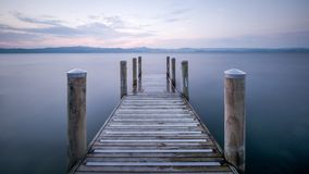Minimalism image of jetty with smooth water background stock image