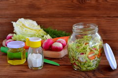 Simple mixed vegetable salad. Salad with cabbage, carrots, radish, dill and olive oil. Vegetable salad in glass jar Stock Photo