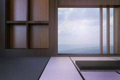 Simple Modern Japanese living room and Minimal window frame and views of mountains and sky Royalty Free Stock Image