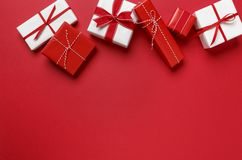 Simple, modern red & white Christmas gifts presents on red background. Festive holiday border. Christmas gifts presents on red background. Simple, classic Stock Photography